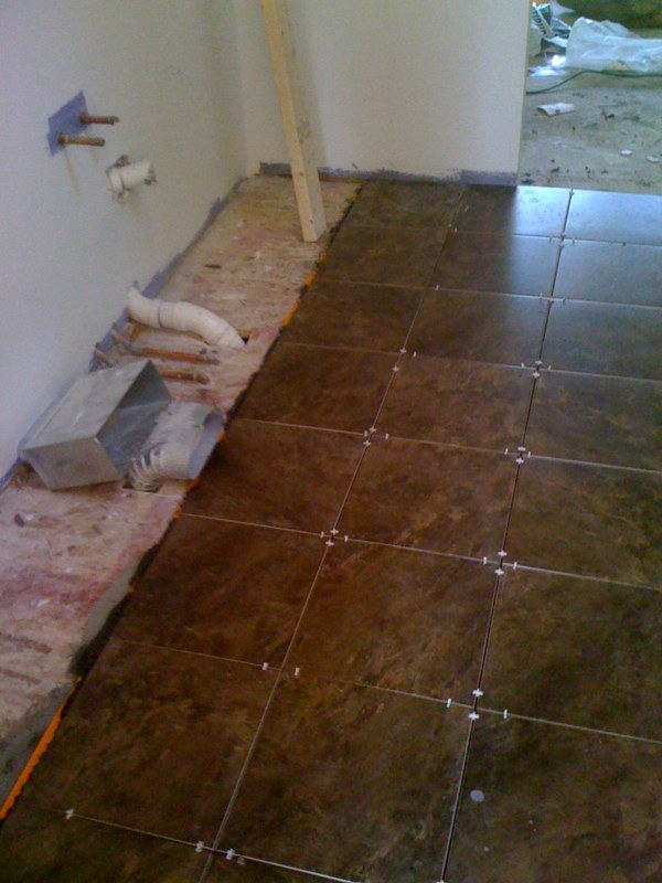Installing tile shower and floor labra design build for Ceramic floor installation