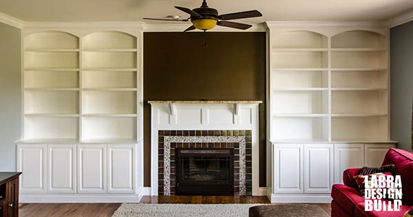 Living room custom built in bookcase novi labra design build for Built in designs living room