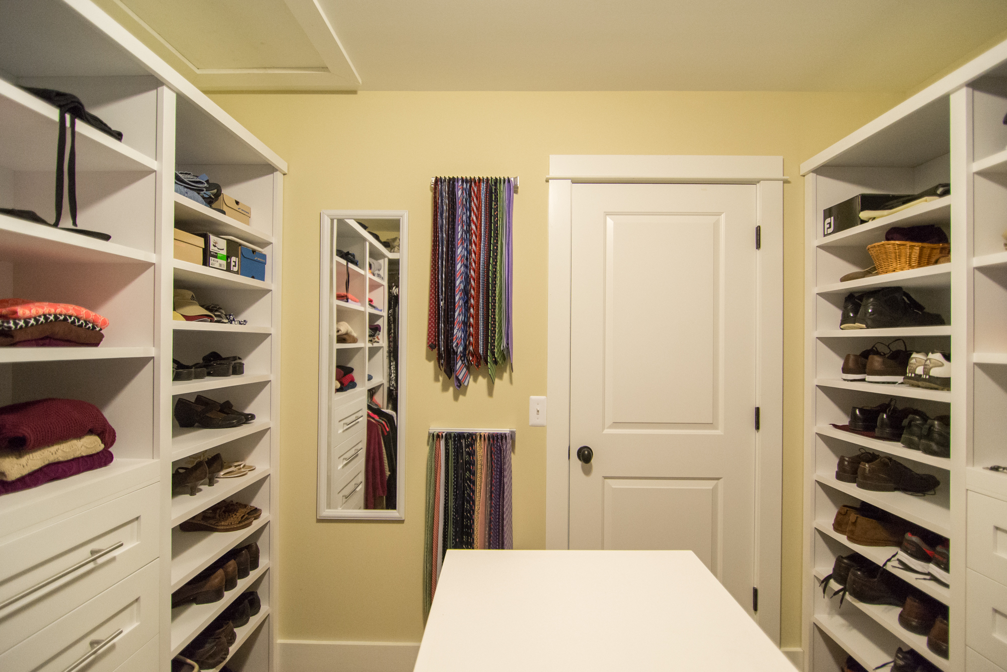 Custom master closet with table labra design build for His and hers walk in closet